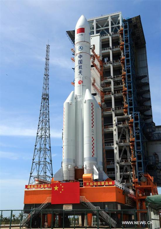 Photo taken on June 26, 2017 shows Long March-5 Y2 carrier rocket at Wenchang Space Launch Center in south China's Hainan Province. Carrying Shijian-18 communication satellite, the rocket was vertically transferred to the launch area at Wenchang Space Launch Center on Monday. China has set the window to launch the rocket between July 2 and 5, according to the State Administration of Science, Technology and Industry for National Defense. (Xinhua/Zhang Wenjun)