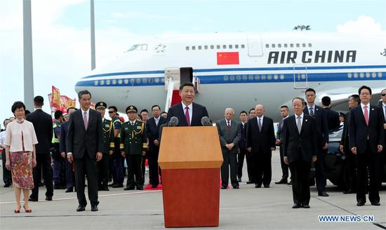 Chinese President Xi Jinping speaks upon his arrival in Hong Kong, south China, June 29, 2017. Xi, also general secretary of the Communist Party of China Central Committee and chairman of the Central Military Commission, is here to attend celebrations marking the 20th anniversary of Hong Kong's return to the motherland, and the inauguration of the fifth-term government of the Hong Kong Special Administrative Region (HKSAR). He will also inspect the HKSAR. (Xinhua/Ma Zhancheng)