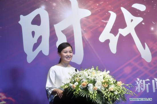 Singer Lei Jia attends the press conference of the documentary on stories of the Chinese Golden Bell Award for Music since its establishment in 2001, in Beijing, capital of China, July 10, 2017. The award is the country's first comprehensive music art prize.(Xinhua/Jin Liangkuai)