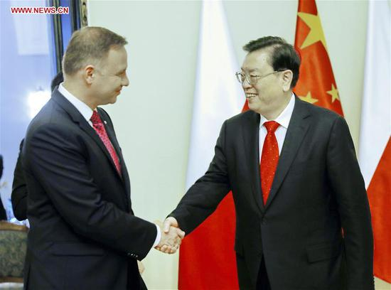 Zhang Dejiang (R), chairman of the Standing Committee of China's National People's Congress (NPC), meets with Polish President Andrzej Duda, in Warsaw, Poland, July 16, 2017. Zhang paid an official friendly visit to Poland from July 12 to 16. (Xinhua/Ju Peng)
