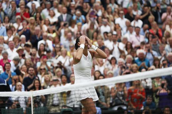 Garbine Muguruza of Spain celebrates after winning the women's singles final match against Venus Williams of the United States at the Championship Wimbledon 2017 at Wimbledon, London, Britain on July 15, 2017. (Xinhua/Jin Yu)