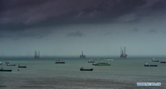 Vessels anchor at port in Haikou, capital of south China's Hainan Province, July 16, 2017. China's national observatory on Sunday renewed a blue alert for typhoon Talas, which is expected to hit Hainan Province and the Beibu Gulf. (Xinhua/Zhao Yingquan)