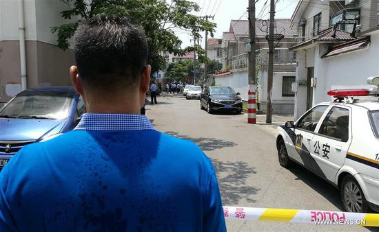 The fire site is cordoned in Yushan Town of Changshu City, east China's Jiangsu Province, July 16, 2017. The fire broke out early Sunday morning in a two-story residential house, leaving 22 people dead and another three injured. (Xinhua)