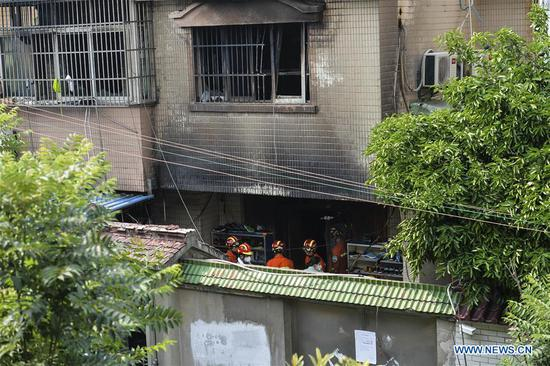 Rescuers work at the site of a house fire in Changshu, east China's Jiangsu Province, July 16, 2017. Police in Jiangsu said they have arrested a suspect for alleged arson after a fire engulfed a house that claimed 22 lives Sunday morning. (Xinhua/Ji Chunpeng)