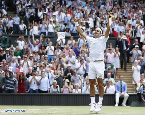 Roger Federer of Switzerland celebrates after winning the men's singles final match with Marin Cilic of Croatia at the Wimbledon Championships 2017 at Wimbledon, London, Britain on July 16, 2017. (Xinhua/Han Yan)