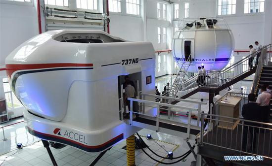 Photo taken on July 17, 2017 shows flight simulators in Tianjin, north China. An aviation company in Tianjin Monday received China's first top-level full flight simulator. The simulator was delivered by ACCEL (Tianjin) Flight Simulation, a joint Sino-U.S. venture between Haite High-Tech and Rockwell Collins, established last year. (Xinhua/Mao Zhenhua)