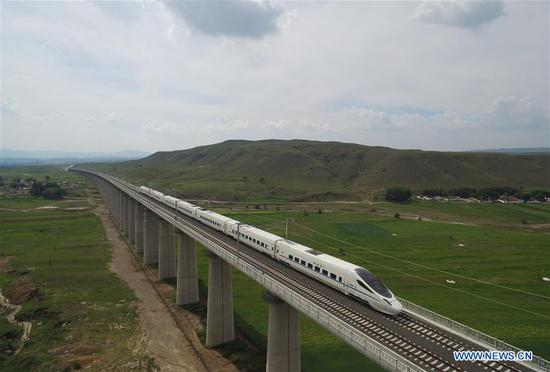 A train runs on the Hohhot section of Zhangjiakou-Hohhot high speed railway in north China's Inner Mongolia Autonomous Region, Aug. 3, 2017. The first high speed railway in Inner Mongolia Autonomous Region linking Hohhot and Ulanqab started operation on Thursday. The 126-kilometer-long railway is part of the high-speed railway that links Hohhot to Zhangjiakou in Hebei Province, the co-host city of the 2022 Olympic Winter Games. And the travel time between Ulanqab and Hohhot will be shortened to 40 minutes. (Xinhua/Wang Zheng)