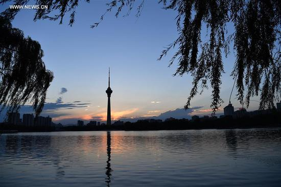 Photo taken on Aug. 7, 2017 shows sunset landscape at Yuyuantan park in Beijing, capital of China. Chinese solar term