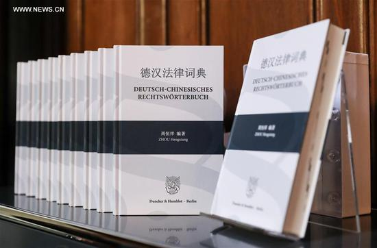 Photo taken on Aug. 8, 2017 shows copies of German-Chinese Law Dictionary during a launch ceremony at the Duncker & Humblot Publishing Company in Berlin, capital of Germany. (Xinhua/Shan Yuqi)