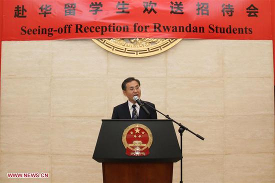 Chinese Ambassador to Rwanda Rao Hongwei delivers a speech at the seeing-off reception for Rwandan students who are going to study in China through scholarships, in Kigali, Rwanda, Aug. 9, 2017. Chinese Embassy in Rwanda on Wednesday evening held a reception, seeing off 37 Rwandans who are going to study in China through scholarships provided by the Chinese government and the Confucius Institute. The scholarship winners are expected to set off for China around the end of August. (Xinhua/Lyu Tianran)