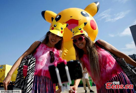 Women take a selfie in front of a large Pikachu figure at a Pokemon Go Park event in Yokohama, Japan August 9, 2017. (Photo/Agencies)