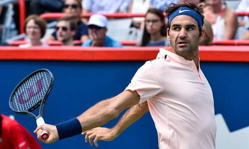 Roger Federer of Switzerland watches as he hits a backhand return against Peter Polansky of Canada at the Rogers Cup on Wednesday in Montreal, Canada. Photo: CFP