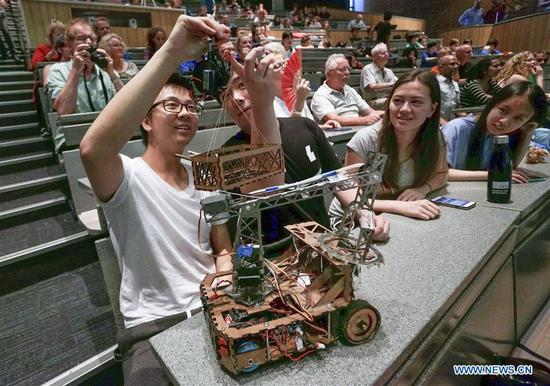 Engineering Physics students adjust their robots during a robot competition at the University of British Columbia (UBC) in Vancouver, Canada, Aug. 10, 2017. Sixteen student teams from UBC participated in a robot challenge to complete multiple tasks including picking up target objects and transportation in the most efficient manner. (Xinhua/Liang sen)