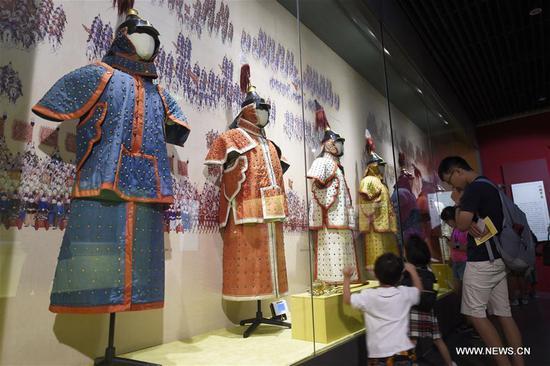 People view exhibits in an exhibition about Emperor Qianlong (1711-1799) at the Zhejiang Museum in Hangzhou, capital of east China's Zhejiang Province, Aug. 10, 2017. Over 200 exhibits were shown in the exhibition. (Xinhua/Li Zhong)