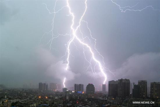 A lightning flashes across the sky in Anshun City, southwest China's Guizhou Province, Aug. 12, 2017. (Xinhua/Lu Wei)