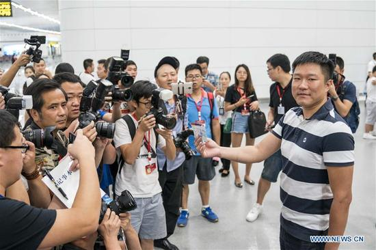 A passenger is interviewed at the T3A terminal of the Jiangbei Airport in Chongqing, southwest China, Aug. 29, 2017. The T3A terminal and the third runway of the airport are put into operation on Tuesday. (Xinhua/Liu Chan)