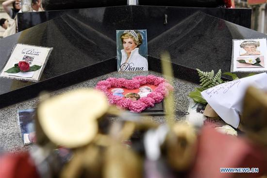 Flowers and photos are seen in commemoration of the Princess Diana in Paris, France on Aug. 31, 2017. People commemorated the 20th anniversary of the tragic death of Princess Diana here on Thursday. Princess Diana died in a car crash in a Parisian underpass on Aug. 31, 1997, at the age of 36. (Xinhua/Chen Yichen)