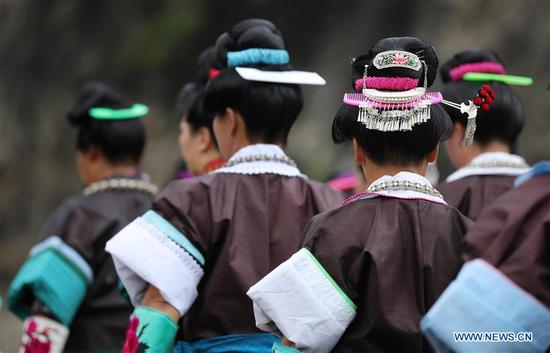 Miao people wearing traditional costumes of Miao ethnic group celebrate the Chixin Festival in Shiqiao Village, Danzhai County of southwest China's Guizhou Province, Sept. 6, 2017. The costumes of Miao people in Danzhai was listed as the national intangible cultural heritage in 2008. (Xinhua/Huang Xiaohai)