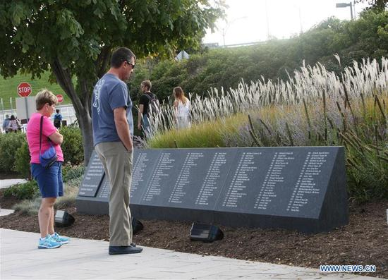 People visit the Pentagon Memorial in honor of the victims of the September 11, 2001 attacks in Arlington, Virginia, the United States, Sept. 10, 2017. (Xinhua/Yan Liang)