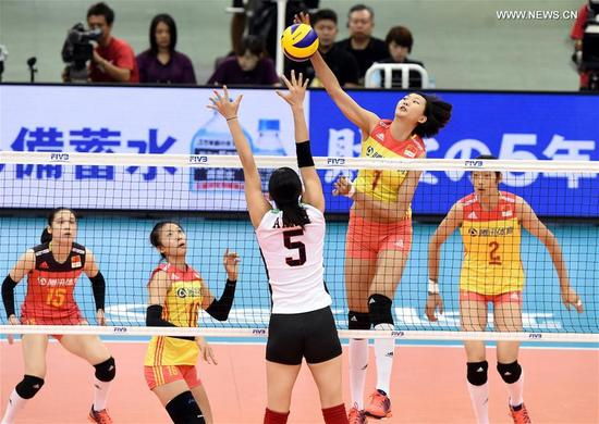 China's Yuan Xinyue (Top) spikes during the round robin match against Japan in FIVB Women's Grand Champions Cup 2017 at Nippon Gaishi Hall in Nagoya, Japan on Sept. 10, 2017. Team China claimed the title with five victories in a row after round robin matches on Sunday. (Xinhua/Ma Ping)