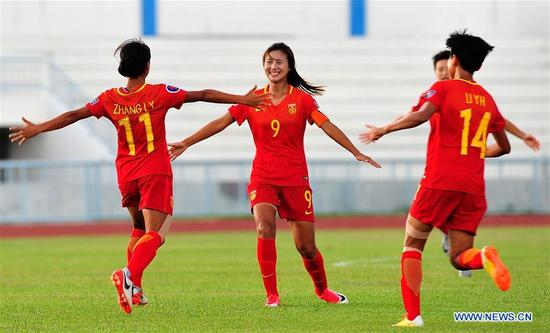 Zhang Linyan (1st L) of China celebrates scoring with her teammate Shen Mengyu (2nd L) during the AFC U-16 Women's Championship 2017 Group A match against South Korea at Institute of Physical Education Stadium in Chonburi, Thailand, Sept. 10, 2017. The match ended with a 2-2 draw.(Xinhua/Rachen Sageamsak)
