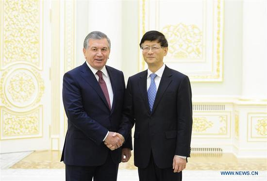 Meng Jianzhu (R), member of the Political Bureau of the Communist Party of China (CPC) Central Committee and head of the Commission for Political and Legal Affairs of the CPC Central Committee, meets with Uzbek President Shavkat Mirziyoyev in Tashkent, Uzbekistan, Sept. 9, 2017. (Xinhua/Sadat)