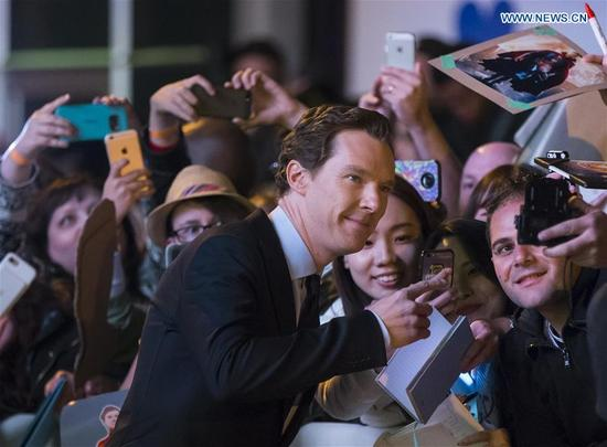 Actor Benedict Cumberbatch (front) poses for photos with fans as he attends the world premiere of the film