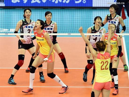 China's players celebrate during the round robin match against Japan in FIVB Women's Grand Champions Cup 2017 at Nippon Gaishi Hall in Nagoya, Japan on Sept. 10, 2017. Team China claimed the title with five victories in a row after round robin matches on Sunday. (Xinhua/Ma Ping)
