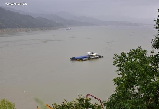 A cargo ship is berthed on the Shawan water of the Three Gorges project in Zigui County, central China's Hubei Province, Sept. 10, 2017. The Three Gorges project started to launch a water storage test to make its water level reach the highest designed mark of 175 meters on Sept. 10, required by China's State Flood Control and Drought Relief Headquarters. The storage is expected to complete at the end of October or on November. (Xinhua/Wang Jiaman)