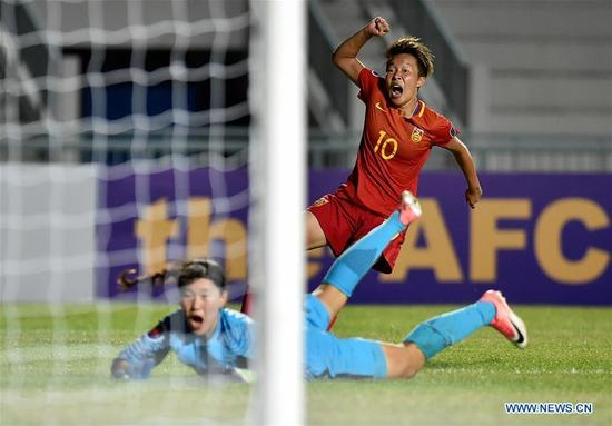 Tang Han (Top) of China celebrates scoring during the AFC U-16 Women's Championship 2017 Group A match against South Korea at Institute of Physical Education Stadium in Chonburi, Thailand, Sept. 10, 2017. The match ended with a 2-2 draw.(Xinhua/Li Mangmang)