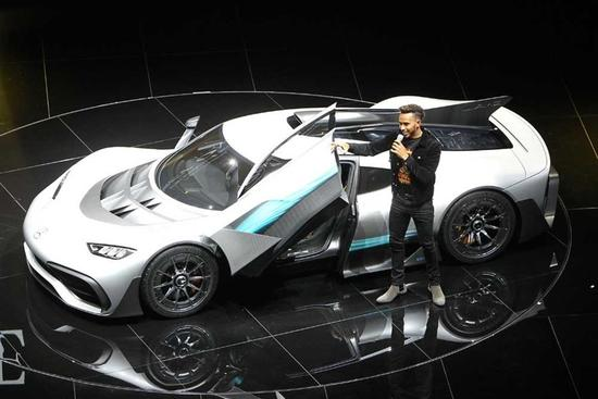 British Formula One racing driver Lewis Hamilton presents a Mercedes AMG Project One car at the IAA auto show in Frankfurt yesterday. — AFP