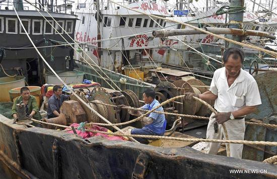Fishermen dock their boats at a port in Jinqing Town of Taizhou, east China's Zhejiang Province, Sept. 12, 2017. China's National Meteorological Center (NMC) Tuesday issued a blue alert for Typhoon Talim, which could intensify to a super typhoon and is likely to hit China's southeastern coast Thursday or Friday. (Xinhua/Liang Minhui)