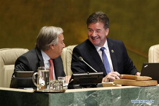 Miroslav Lajcak (R), President of the 72nd session of the United Nations General Assembly, talks with UN Secretary-General Antonio Guterres after the opening of the 72nd session of the UN General Assembly at the UN headquarters in New York, Sept. 12, 2017. Miroslav Lajcak on Tuesday declared the opening of the 72 session of the decision-making body of the United Nations. (Xinhua/Li Muzi)