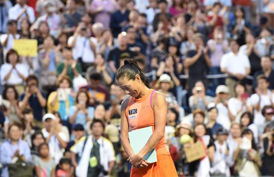 Fans applaud Japan's Kimiko Date during a ceremony after the last match of her career against Serbian Aleksandra Krunic in the first round of the Japan Women's Open in Tokyo on September 12, 2017. Date retired from professional tennis just shy of her 47th birthday.