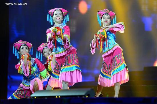 Actresses perform during a gala of the 19th Nanning international folk song art festival in Nanning, capital of south China's Guangxi Zhuang Autonomous Region, Sept. 12, 2017. (Xinhua/Li Xuanli)