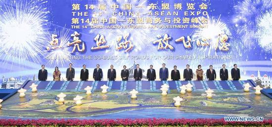 Chinese Vice Premier Zhang Gaoli (8th L) attends the unveiling ceremony for the opening of the 14th China-ASEAN Expo and the China-ASEAN Business and Investment Summit with foreign dignitaries and guests, in Nanning, capital of south China's Guangxi Zhuang Autonomous Region, Sept. 12, 2017. (Xinhua/Wang Ye)