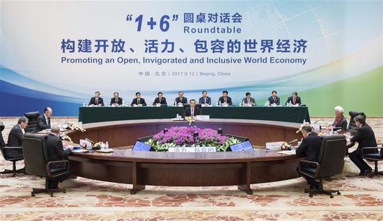 China's Premier Li Keqiang, together with World Bank Group (WBG) President Jim Yong Kim, International Monetary Fund (IMF) Managing Director Christine Lagarde, World Trade Organization (WTO) Director-General Roberto Azevedo, International Labor Organization (ILO) Director-General Guy Ryder, Organization for Economic Cooperation and Development (OECD) Secretary-General Angel Gurria and Financial Stability Board (FSB) Chairman Mark Carney, hold the Second