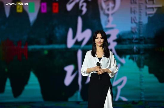 Singer Tan Weiwei performs during a gala of the 19th Nanning international folk song art festival in Nanning, capital of south China's Guangxi Zhuang Autonomous Region, Sept. 12, 2017. (Xinhua/Li Xuanli)