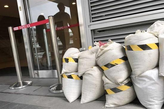Sandbags are seen outside landmark building Taipei 101 in Taiwan's capital city yesterday as the island braced itself for the arrival of Typhoon Talim. — Reuters