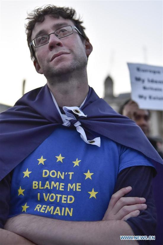 A man takes part in a rally at Trafalgar Square in London, Britain on Sept. 13, 2017. A rally was held here on Wednesday calling to maintain the rights of the EU citizens in Britain and British citizens in the EU after Brexit. (Xinhua/Stephen Chung)