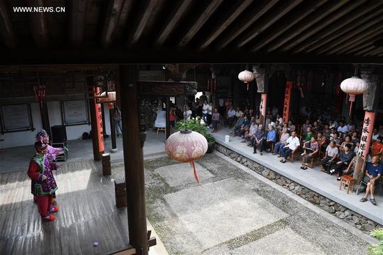 People watch performance of Chinese traditional Shaoxing Opera in Xianju County of Taizhou, east China's Zhejiang Province, Sept. 13, 2017. (Xinhua/Huang Zongzhi)