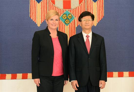 Croatian President Kolinda Grabar-Kitarovic (L) meets with Chinese President Xi Jinping's special envoy Meng Jianzhu, who is also member of the Political Bureau of the Communist Party of China (CPC) Central Committee and head of the Commission for Political and Legal Affairs of the CPC Central Committee, in Zagreb, Croatia, on Sept. 13, 2017. (Xinhua/Gao Lei)