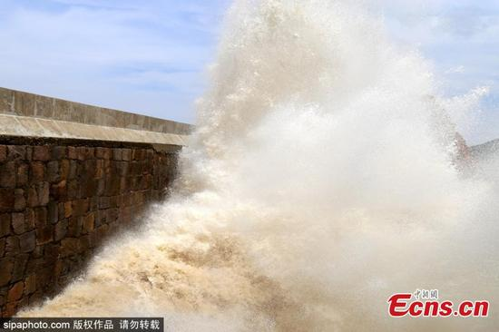 Turbulent sea waves hit the shore in Shitang town of Wenling, east China's Zhejiang Province, September 13, 2017. China's National Meteorological Center (NMC) Wednesday continued its orange alert for Typhoon Talim, which could intensify to a super typhoon and is likely to hit China's southeastern coast Thursday or Friday. At 5 a.m. Wednesday, the eye of Talim, this year's 18th typhoon in the region, was above the northwestern Pacific Ocean, 760 km southeast of Zhejiang Province, packing winds up to 38 meters per second. (Photo/Sipaphoto)