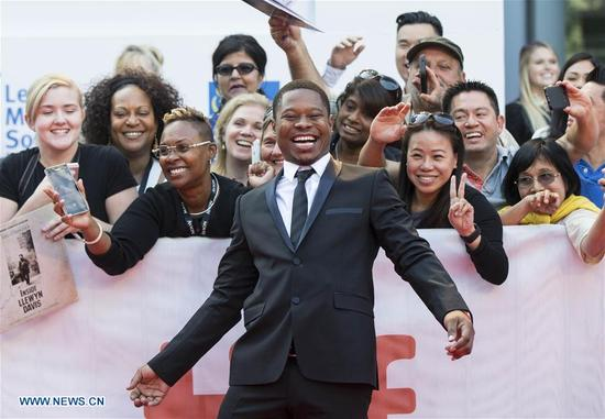 """Actor Jason Mitchell poses for photographs at the international premiere of the film """"Mudbound"""" at Roy Thomson Hall during the 2017 Toronto International Film Festival in Toronto, Canada, Sept. 12, 2017. (Xinhua/Zou Zheng)"""