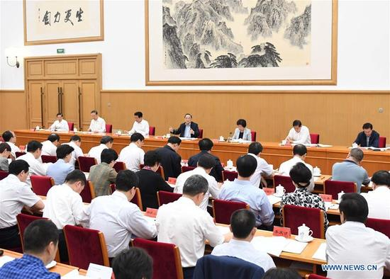 Yu Zhengsheng, chairman of the National Committee of the Chinese People's Political Consultative Conference (CPPCC), attends a two-day symposium on historical issues concerning Xinjiang Uygur Autonomous Region, in Beijing, capital of China. The symposium was held from Sept. 12 to 13, 2017. (Xinhua/Zhang Duo)