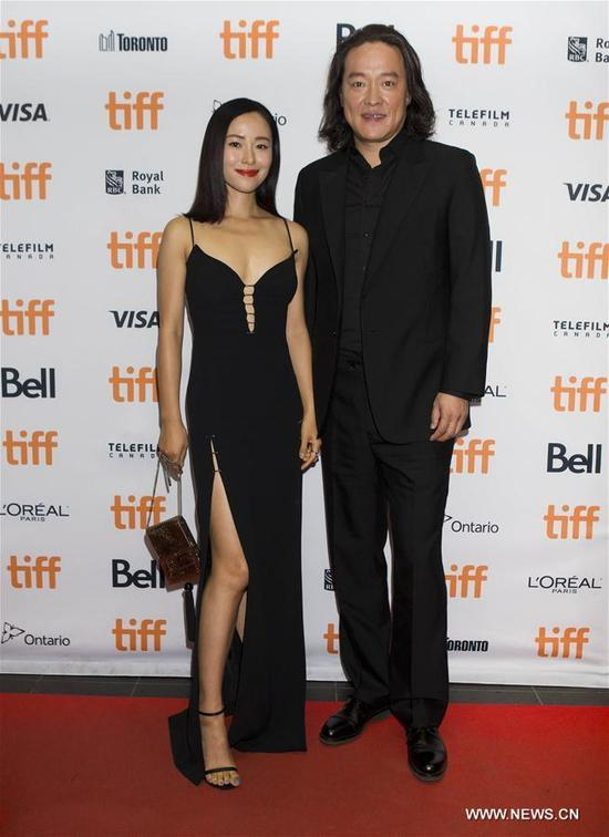 """Director Zhao Hantang (L) and actress Jiang Yiyan attend the press conference of the North American premiere of Chinese film """"Seventy-Seven Days"""" in Toronto, Canada, Sept. 13, 2017. (Xinhua/Zou Zheng)"""