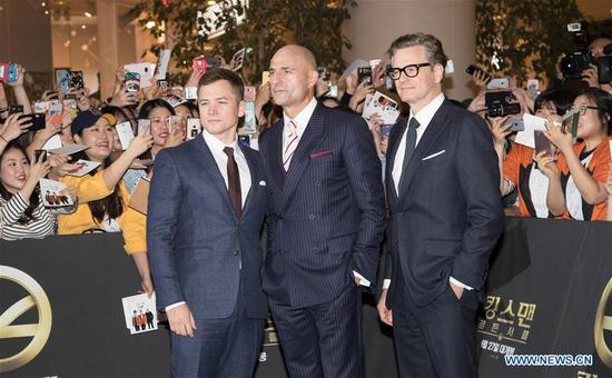 """Actor Taron Egerton, Mark Strong and Colin Firth (L to R) attend the red carpet event of the movie """"KING'S MAN:THE GOLDEN CIRCLE"""" in Seoul, South Korea, Sept. 20, 2017. The film will be released in South Korea on Sept. 27. (Xinhua/Lee Sang-ho)"""