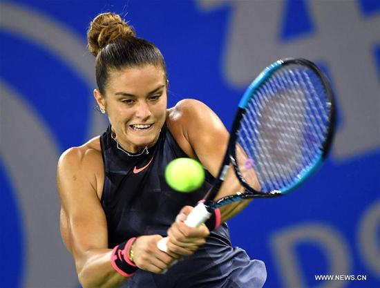 Maria Sakkari of Greece returns the ball during the singles quarterfinal match against Alize Cornet of France at 2017 WTA Wuhan Open in Wuhan, capital of central China's Hubei Province, on Sept. 28, 2017. Maria Sakkari won 2-0. (Xinhua/Cheng Min)