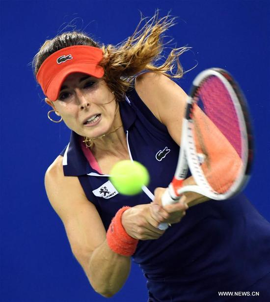 Alize Cornet of France returns the ball during the singles quarterfinal match against Maria Sakkari of Greece at 2017 WTA Wuhan Open in Wuhan, capital of central China's Hubei Province, on Sept. 28, 2017. Alize Cornet lost 0-2. (Xinhua/Cheng Min)