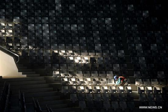 A worker cleans some benches at Istora Senayan for the 2018 Asian Games in Jakarta, Indonesia, on Oct. 4, 2017. Jakarta and Palembang in Indonesia will host the 2018 Asian Games from Aug. 18 to Sept. 2, 2018. (Xinhua/Agung Kuncahya B.)